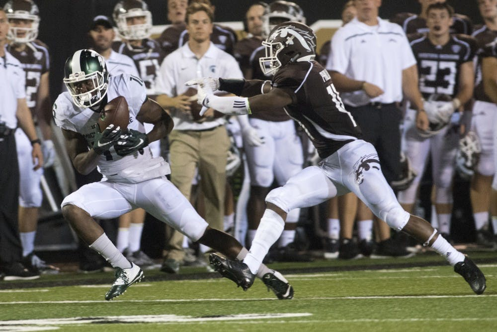 <p>Western Michigan cornerback Darius Phillips chases after senior wide receiver Aaron Burbridge on Sept. 4, 2015, during a game against Western Michigan at Waldo Stadium in Kalamazoo, Mich. The Spartans beat the Broncos, 37-24. Julia Nagy/The State News</p>