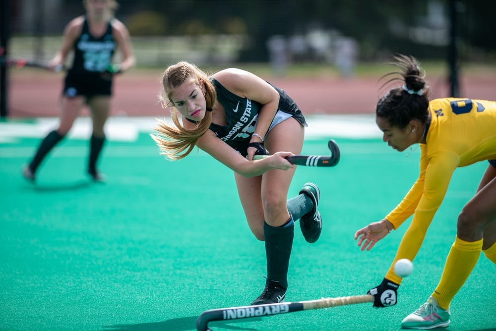 <p>MSU midfielder Emma O&#x27;Neill passes the ball during a game against Michigan on April 2, 2021.</p>