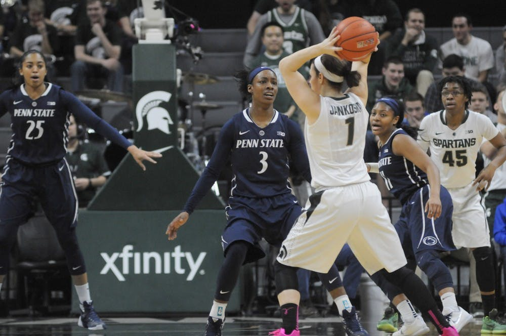 Junior guard Tori Jankoska throws the ball as she is defended by Penn State guard Brianna Banks during the game against Penn State on Feb. 11, 2016 at the Breslin Center. Spartans were defeated by the Nittany Lions  65-61.