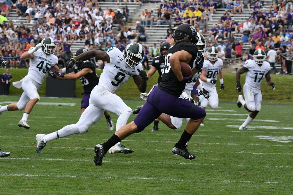 <p>Junior defensive back Dominique Long looks to make a tackle during the game against Northwestern on Sept. 21, 2019 at Ryan Field. Spartans led the Wildcats 14-3 at the half.</p>