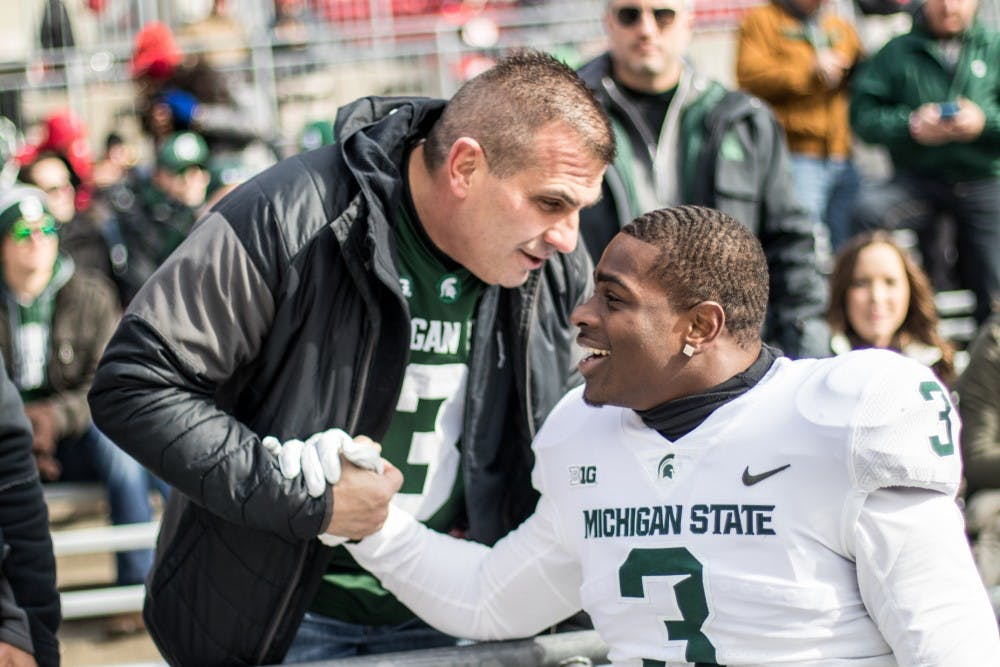 Junior running back LJ Scott (3) talks to a Spartans fan before the Ohio State game, on Nov. 11, at Ohio Stadium. The Spartans fell to the Buckeyes, 48-3.