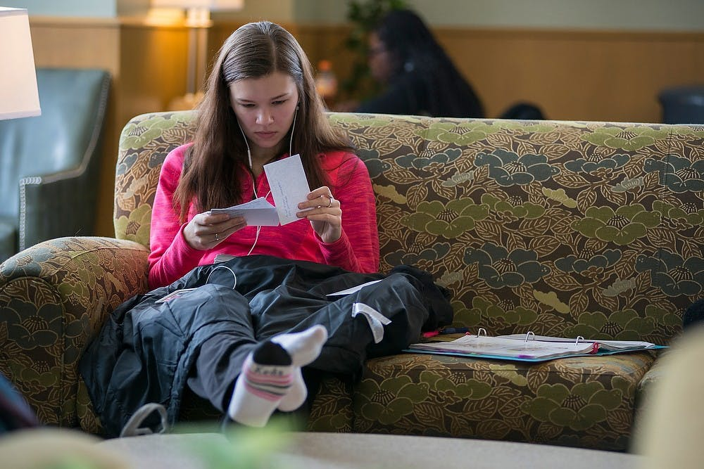 <p>Prenursing freshman Bridget Kutsche studies Feb. 21, 2015, in the women's lounge at the MSU Union. The women's lounge is Kutsche's preferred place to study for the quiet atmosphere.</p>