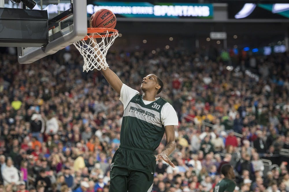 <p>Then-freshman forward Marcus Bingham Jr. (30) shoots a layup during Michigan State&#x27;s NCAA Men&#x27;s Basketball Final Four open practice at U.S. Bank Stadium in Minneapolis on April 5, 2019. (Nic Antaya/The State News)</p>
