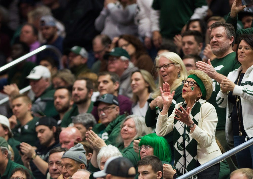 A Michigan State fan dances during the second round game of the NCAA tournament against Minnesota at Wells Fargo Arena March 23, 2019. The Spartans defeated the Gophers, 70-50.