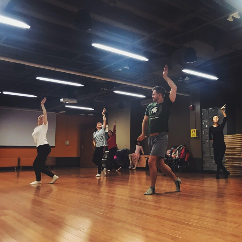 Members of MSU's Mulan Dance club practice routines. The club offers free traditional Chinese folk dancing classes to international and domestic students. Photo courtesy of Mulan Dance.