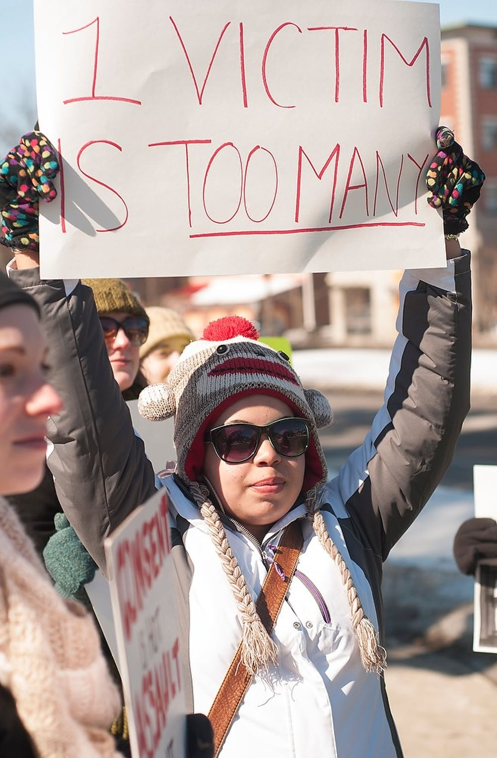 <p>English sophomore Kelsey Wiley holds up a sign Feb. 28, 2015, during the V-Day March from the Union, 49 Abbot Rd., to the Wharton Center on 750 East Shaw Lane. Individuals taking part in the march held signs protesting sexual violence and rape culture. Alice Kole/The State News</p>