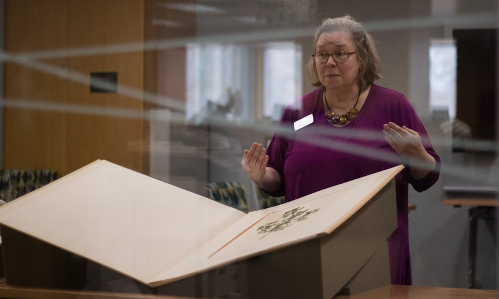 Ruth Ann Jones, the special collections education and outreach librarian, explains the history behind the collection's largest book at the Main Library on Jan. 11, 2019.