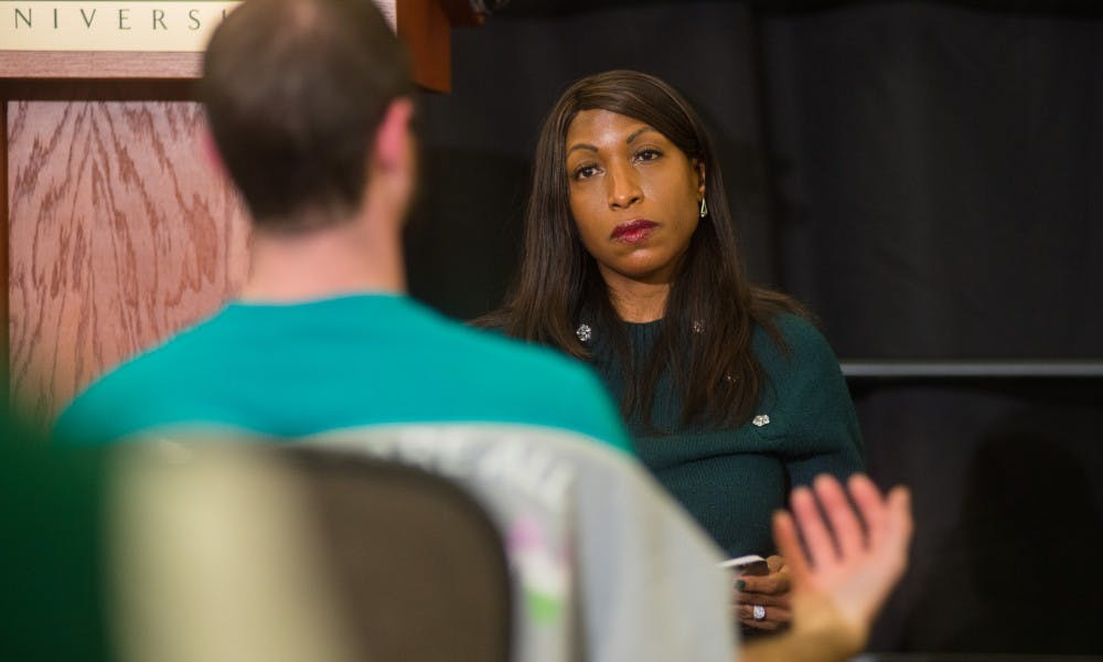 Trustee Brianna T. Scott listens to feedback from a member of Reclaim MSU during a town hall meeting at the Kellogg Center March 18, 2019.