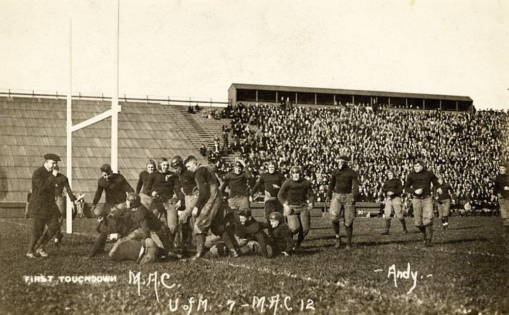 <p>The first touchdown in the M.A.C. vs. U-M game in 1913. The Aggies defeated the Wolverines for the first time, 12-7. Photo courtesy of MSU Archives.</p>