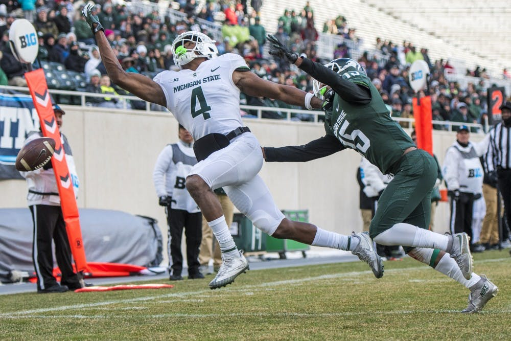 Redshirt freshman wide receiver C.J. Hayes (4) fails to receive a pass during the annual Green and White spring game on April 7, 2018 at Spartan Stadium. White defeated Green, 32-30.