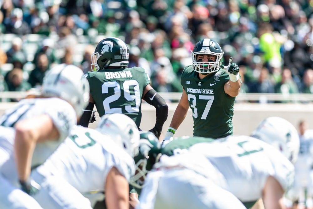 Junior linebacker Dante Razzano (37) makes adjustments at the line of scrimmage. The green team beat the white team, 42-26, in the MSU Spring football game at Spartan Stadium on April 13, 2019.