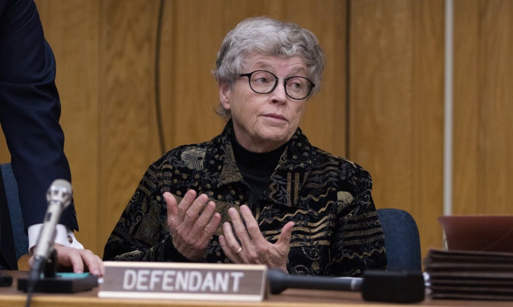Former Michigan State President Lou Anna K. Simon shrugs about scheduling during her arraignment at the Eaton County Courthouse on Nov. 26, 2018. She is being charged with four counts of lying to a Peace Officer about the Nassar Investigation.