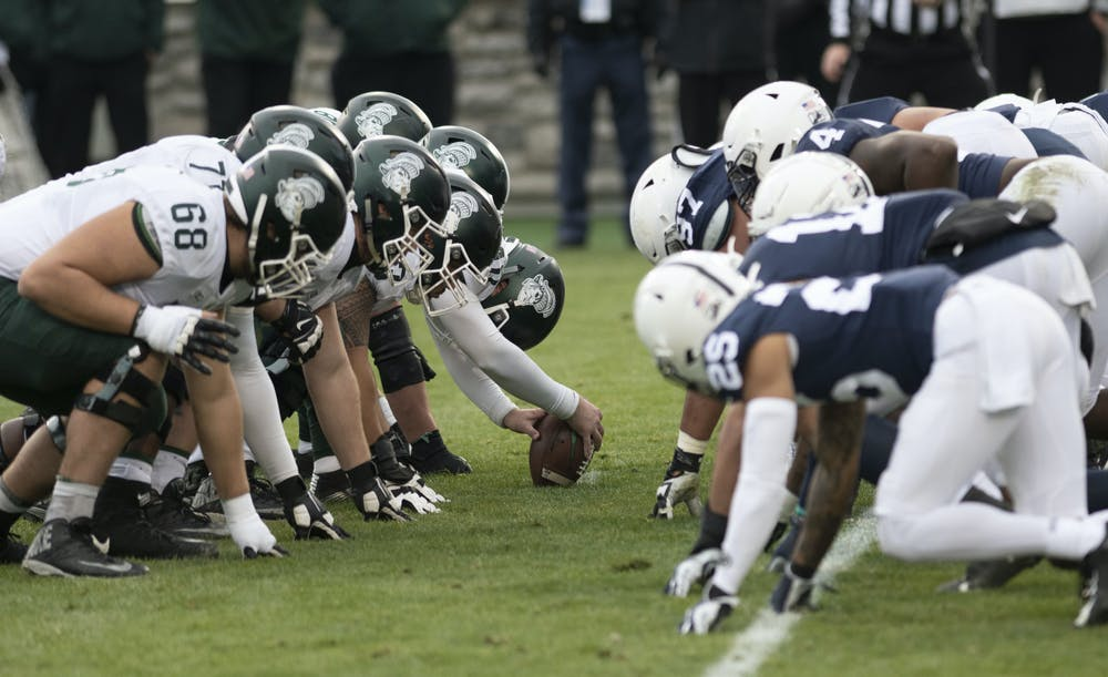 <p>Penn State and Michigan State prepare for the snap during the game on Saturday, Dec. 12, 2020, in Beaver Stadium. Penn State won 39-24. Photos courtesy of Lily LaRegina, photographer and photo editor at The Daily Collegian.</p>
