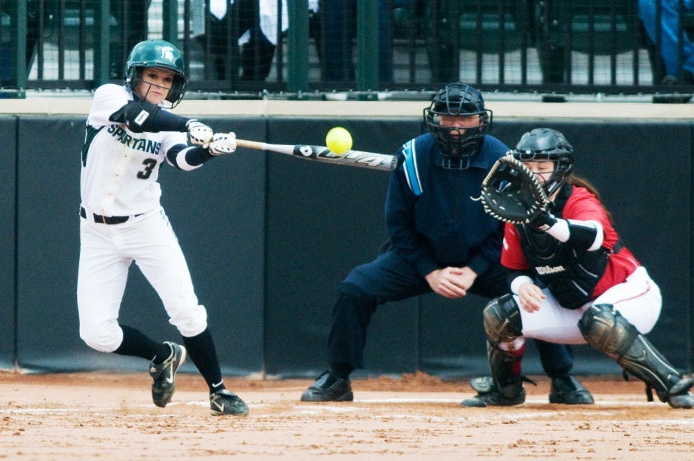 Sophomore outfielder Kylene Hopkins swings the bat to hit the ball during Saturday's game against Wisconsin at Secchia Stadium. The Spartans defeated the Badgers, 8-0, in the fifth inning. Lauren Wood/The State News