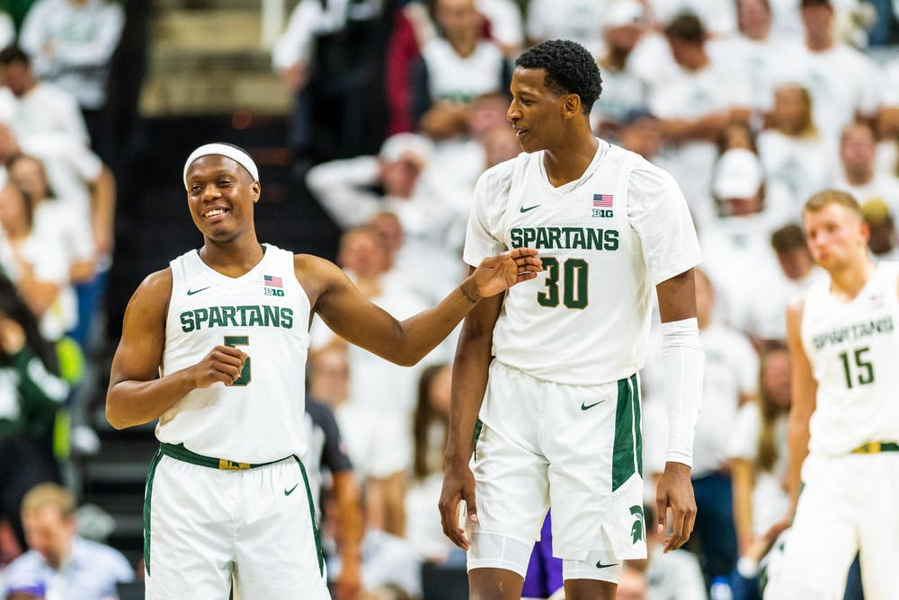 <p>Senior guard Cassius Winston (left) and sophomore forward Marcus Bingham Jr. (right) talk after a timeout. The Spartans defeated the Britons, 85-50, at half on Oct. 29, 2019 at the Breslin Student Events Center. </p>