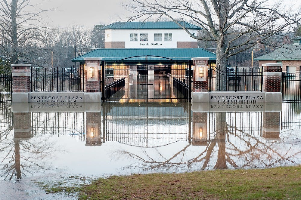 <p>Pentecost Plaza and parts of the Old College Field, including DeMartin Stadium, Secchia Stadium and McLane Stadium, were under water April 20, 2013. The water level of the Red Cedar River raised above 7 feet, flooding part of the bank from the Main Library to Kellogg Center.</p>