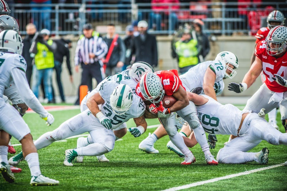 Ohio State running back J.K. Dobbins (2) is tackled during the game against Ohio State, on Nov. 11, 2017, at Ohio Stadium. The Spartans were defeated by the Buckeys, 48-3.