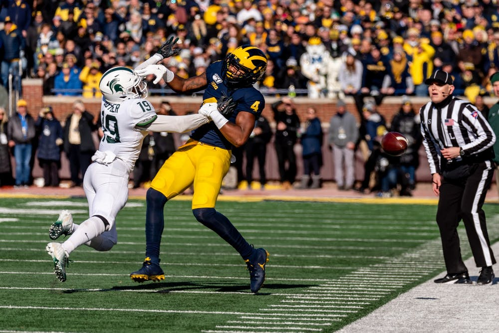 Senior corner back Josh Butler (19) tips a pass away from Michigan wide receiver Nico Collins (4). The Spartans fell to the Wolverines, 44-10, at Michigan Stadium on November 16, 2019.