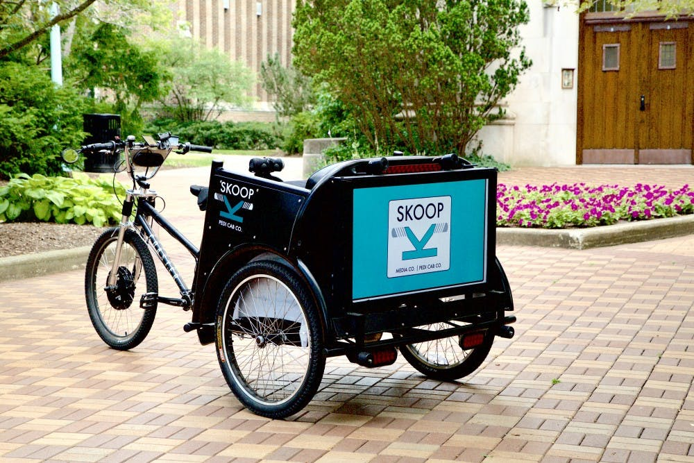 <p>One of the pedicabs used in advertising management sophomore Josh Cooper's Skoop transportation service. <strong>Photo courtesy of Skoop, Inc.</strong></p>
