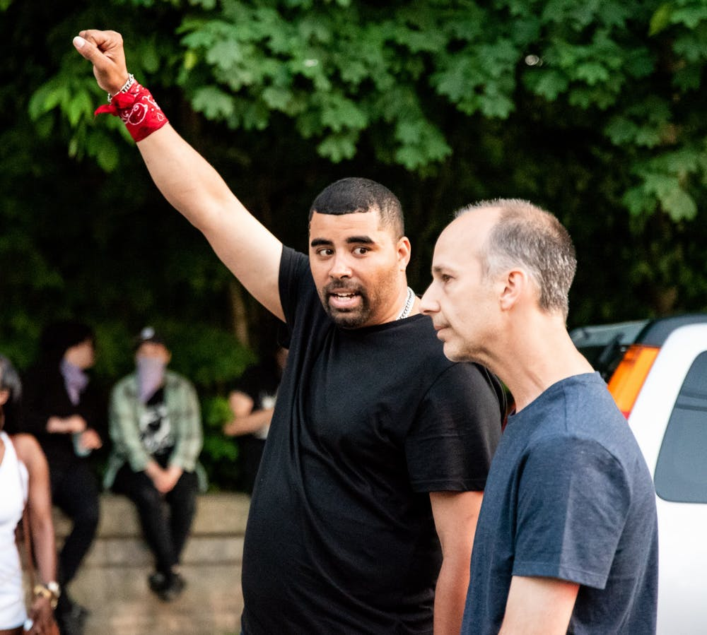 <p>Paul Birdsong speaks with Lansing Mayor Andy Schor outside Schor&#x27;s house after Birdsong led a group of protesters on a two-mile march from the Capitol to the mayor&#x27;s house June 6, 2020. Schor was not home when the group arrived.</p>