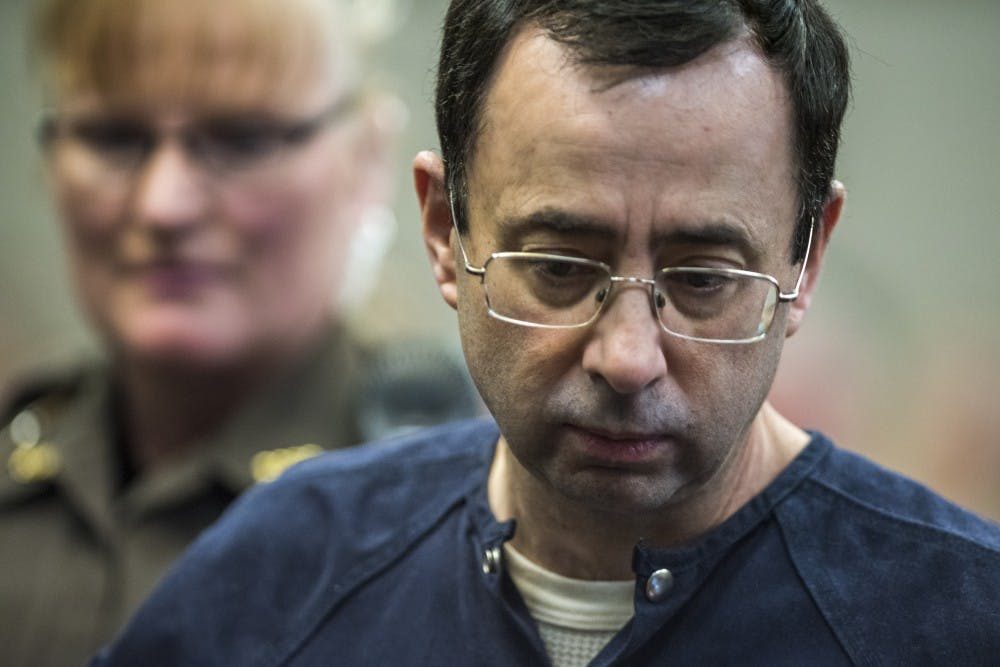 <p>Ex-MSU and USA Gymnastics Dr. Larry Nassar makes his appearance on the fifth day of his sentencing on Jan. 22, 2018 at the Ingham County Circuit Court in Lansing.&nbsp;</p>