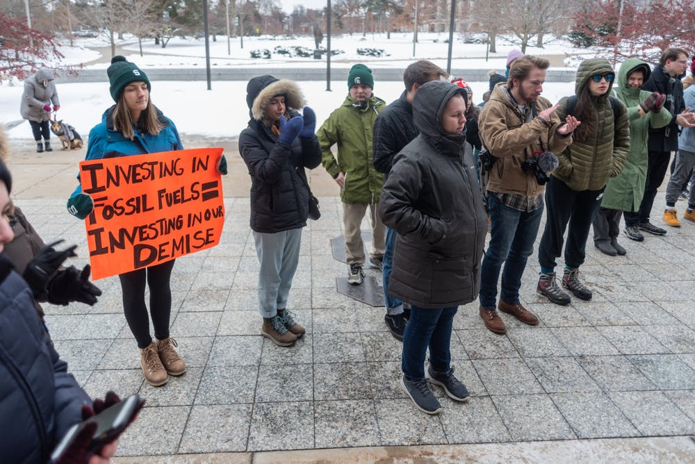 <p>Protesters applaud points made during a Divestment Day protest outside of the Hannah Administration Building on Feb. 14, 2020. </p>