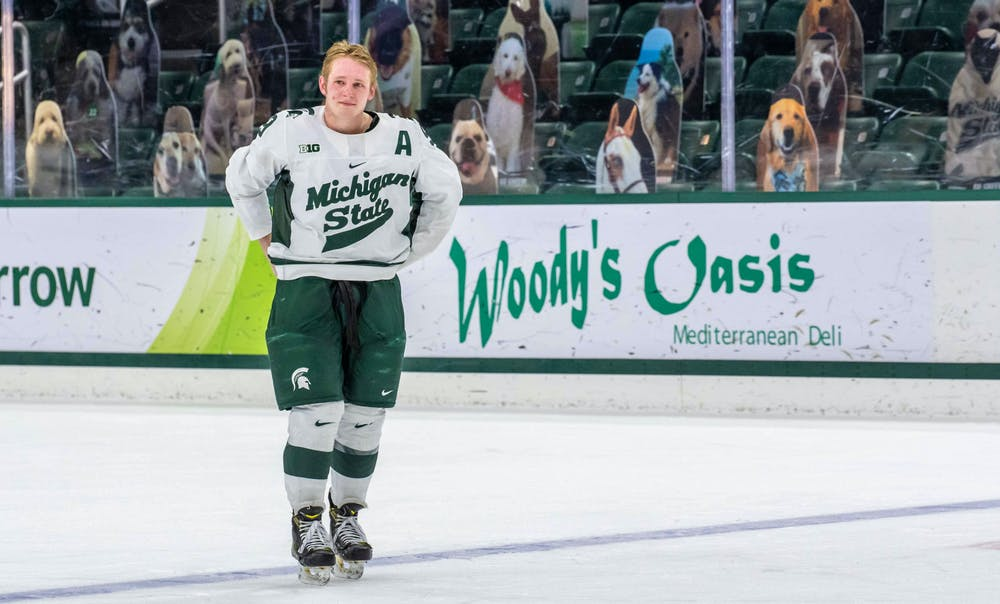Senior Mitchell Lewandowski (9) stares with teary eyes into the stands where his parents are after hugging all his teammates. The Fighting Irish shutout the Spartans 2-0 on Feb. 27, 2021.
