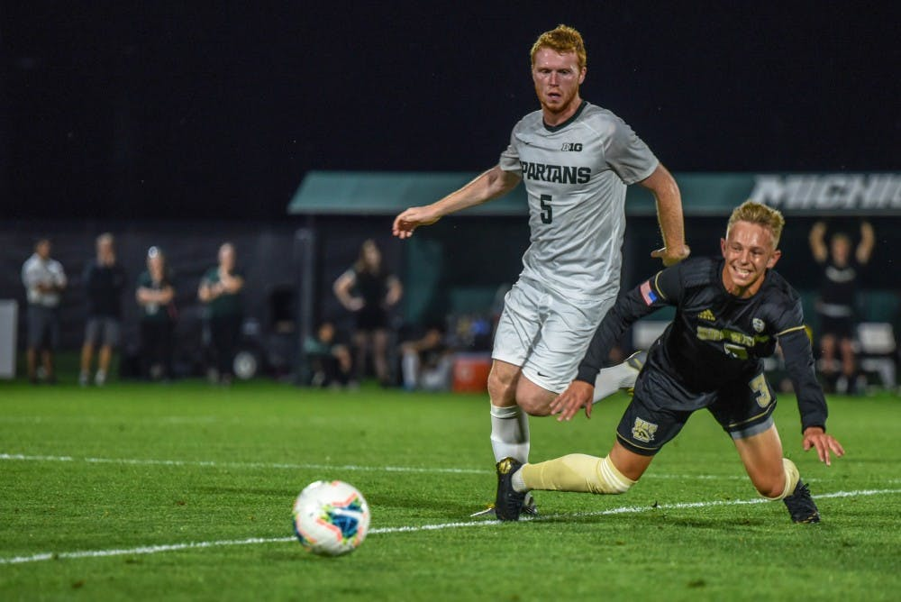 <p>Senior midfielder Michael Pimlott (5) fights for the ball during the game against Western Michigan on Sept. 20, 2019. The Spartans fell to the Broncos, 0-1.</p>