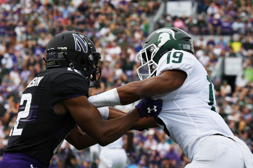 <p>Then-senior cornerback Josh Butler (19) blocks a Northwestern player during the game at Ryan Field on Sept. 21, 2019. MSU defeated Northwestern 31-10.</p>