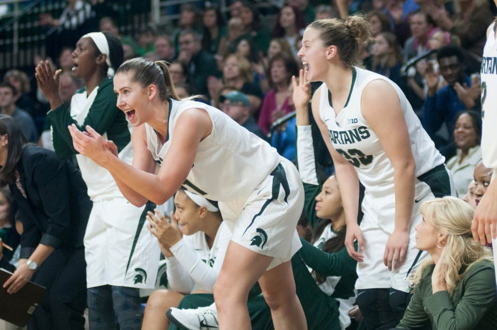 <p>Freshman center Hana Vesela, left, and freshman center Jenna Allen cheer on their teammates during the game against Michigan Tech on Nov. 8, 2015 at Breslin Center. The Spartans defeated the Huskies, 74-43.</p>