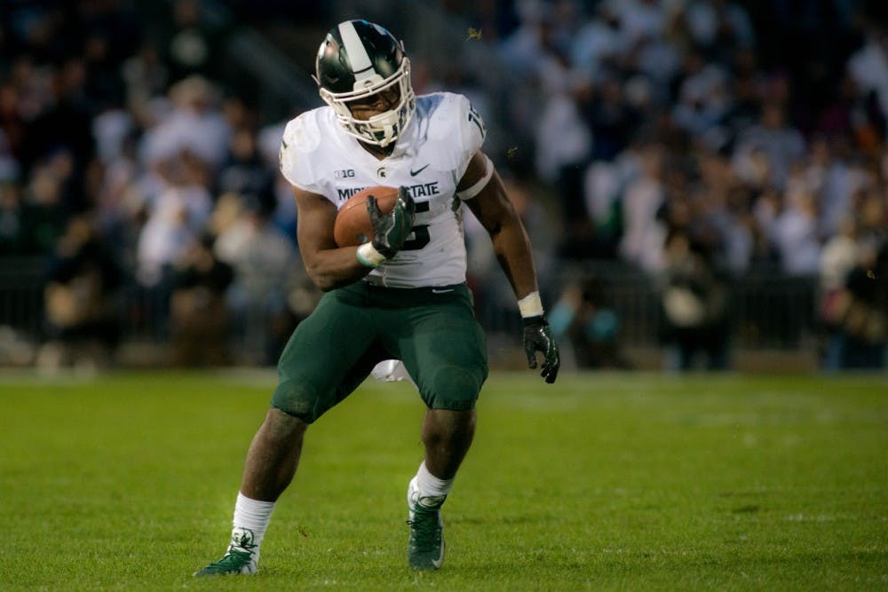 <p>Then freshman running back La&#x27;Darius Jefferson (15) rushes the ball during the game against Penn State at Beaver Stadium on Oct. 13, 2018. The Spartans defeated the Nittany Lions 21-17.</p>