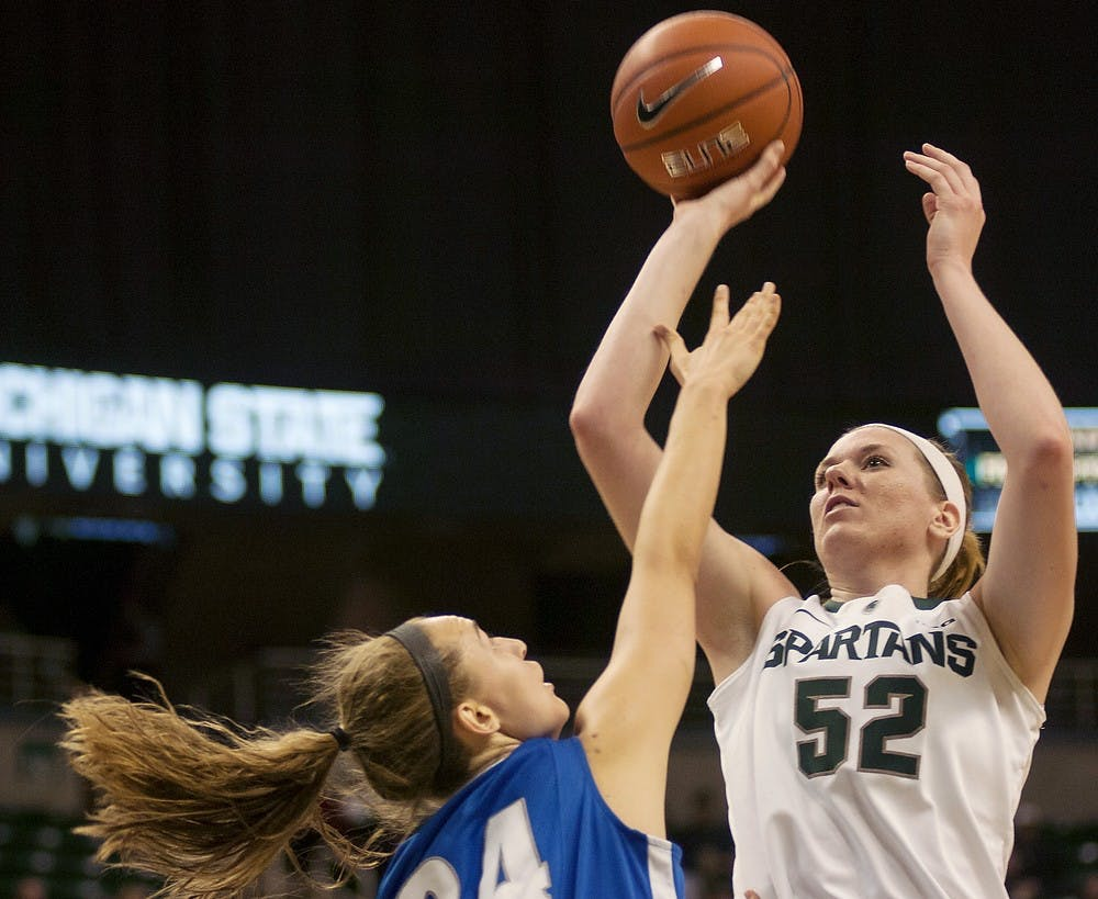 "<p>Junior forward Becca Mills shoots the ball over <span class=""caps"">IPFW</span> forward Rebecca Bruner on Dec. 1, 2013, at Breslin Center. <span class=""caps"">MSU</span> lost to <span class=""caps"">IPFW</span>, 81-74. Margaux Forster/The State News</p>"