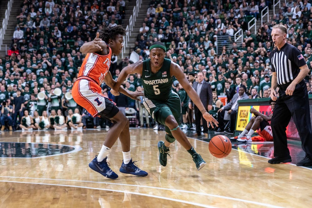 <p>Senior guard Cassius Winston (right) drives on Illinois guard Ayo Dosunmu (left). The Spartans defeated the Illini, 76-56, at the Breslin Student Events Center on January 2, 2020.</p>