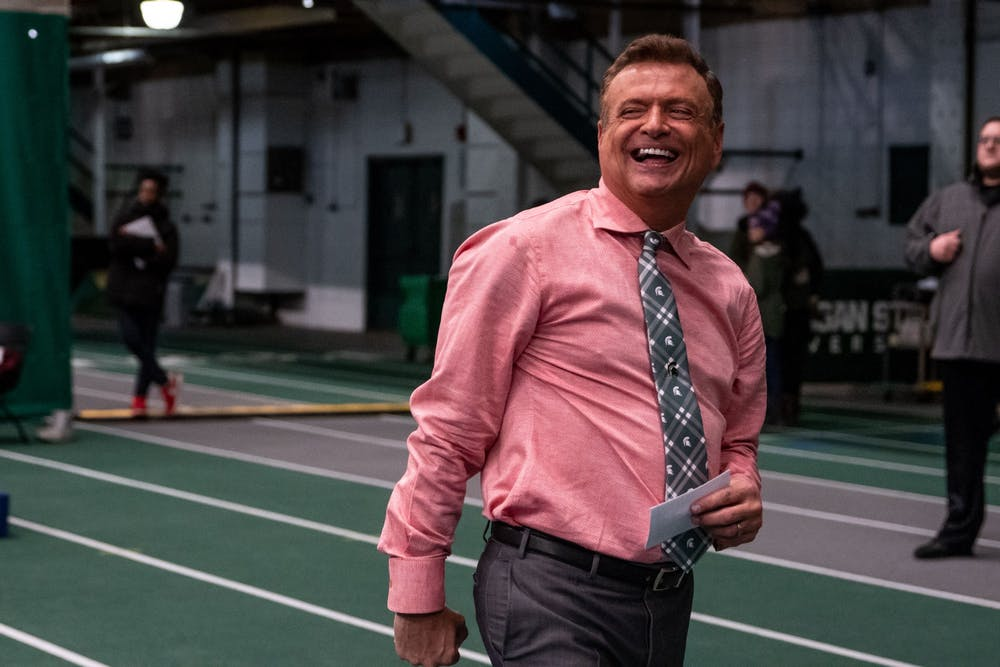 <p>Head Coach Mike Rowe smiles after winning the meet against Ohio State on Jan. 18 at Jenison Fieldhouse. The Spartans defeated the Buckeyes, 195.450-195.325.</p>