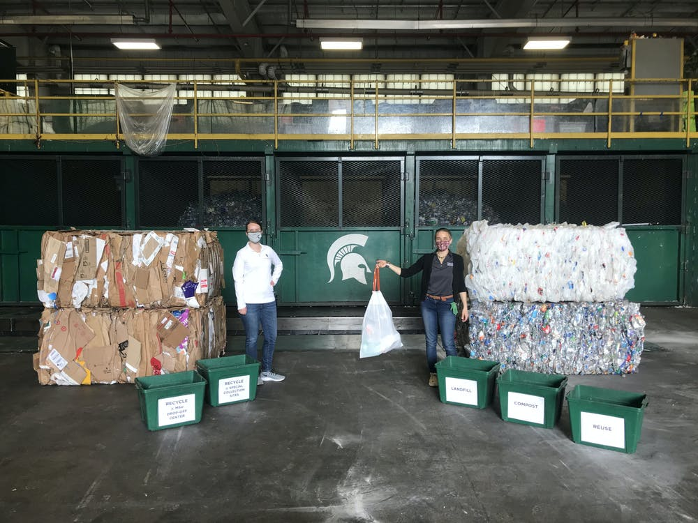 <p>Laura Young and Katie Deska inside the material recovery facility of the MSU Surplus Store &amp; Recycling Center. Photo courtesy of SSRC staff</p>