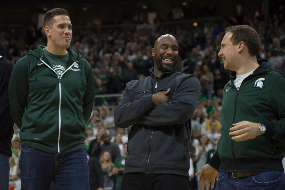 Former men's basketball players left to right, Jason Andreas, Mateen Cleaves and Matt Ishbia chat during halftime during the game against Florida on Dec. 12, 2015 at Breslin Center. The 2000 basketball team was honored during halftime.