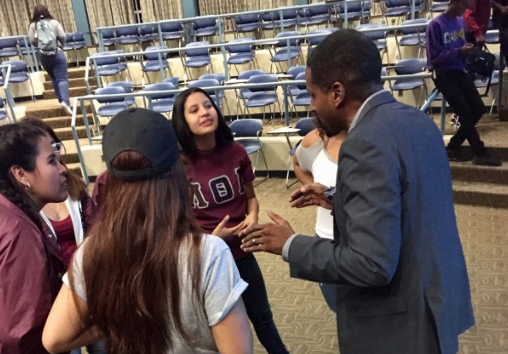 <p>Guest speaker Rasheed Ali Cromwell speaks to students after speaking at Erickson Kiva &nbsp;Tuesday, Sept. 12.</p>