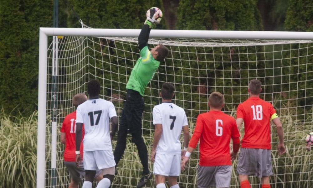 Sophomore goalie Jimmy Hague (1) jumps to catch the ball during the game against Bowling Green on Sept. 28, 2016. The Spartans defeated the Falcons, 1-0.