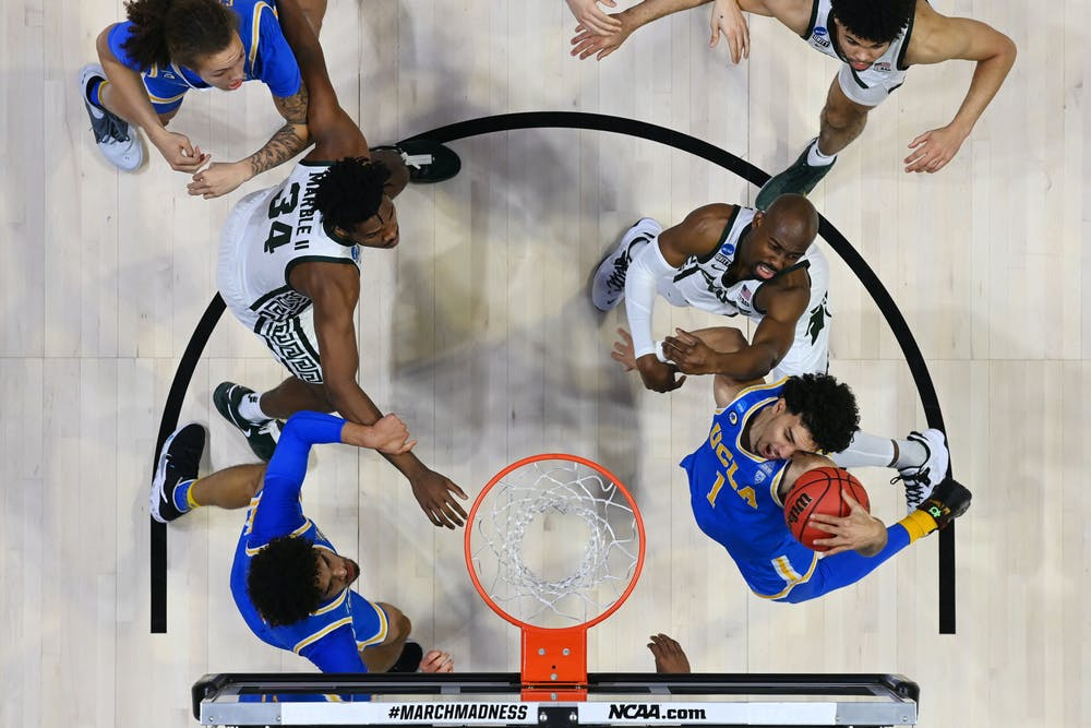 <p>WEST LAFAYETTE, IND. — MARCH 18: Jules Bernard (1) of the UCLA Bruins grabs a rebound against the Michigan State Spartans in the First Four round of the 2021 NCAA Division I Men&#x27;s Basketball Tournament. (Photo credit: Andy Hancock/NCAA Photos via Getty Images)</p>