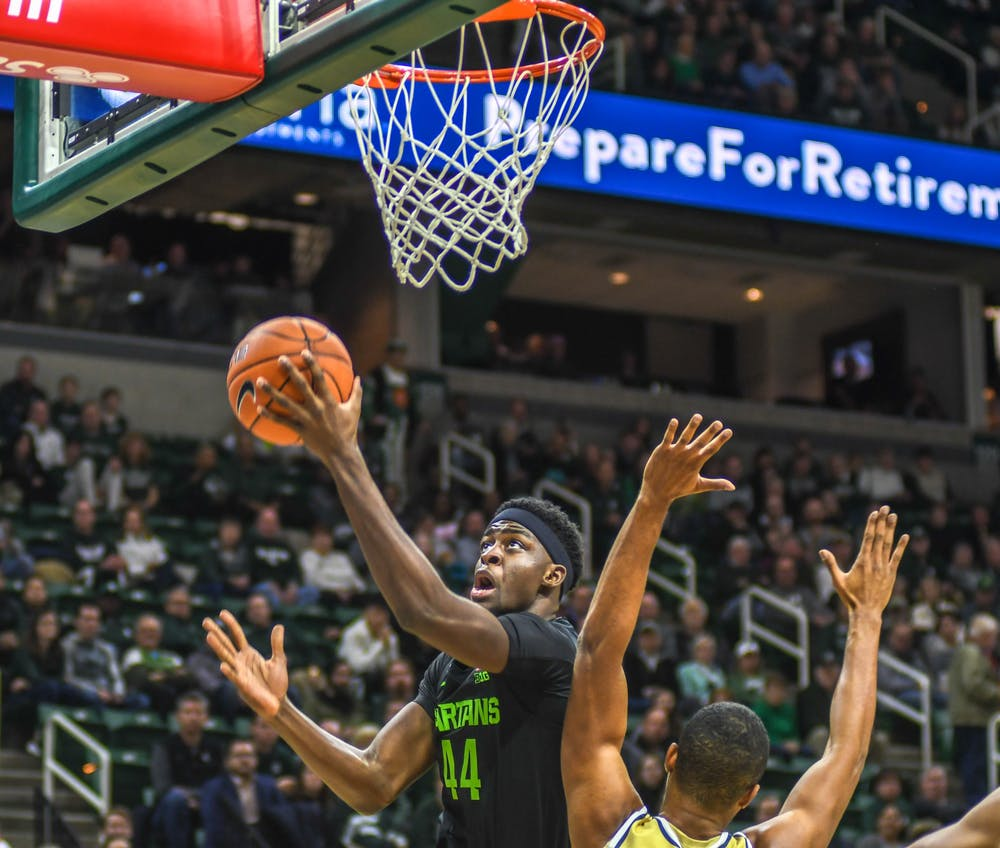 <p>Sophomore forward Gabe Brown (44) dunks the ball during the game against the Charleston Southern Buccaneers on Nov. 18, 2019 at Breslin Center. The Spartans defeated the Buccaneers, 94-46.</p>