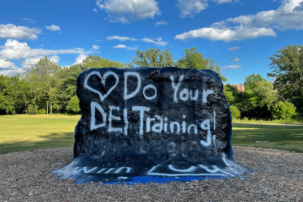 """After The Rock was defaced for the eighth time, the phrase was quickly covered up with, """"Do Your DEI Training""""."""