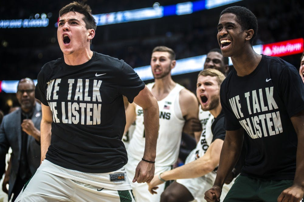 Redshirt sophomore guard Conner George (41) and freshman guard Brock Washington (14) cheer on the Spartans during the Champions Classic during the game against Duke on Nov. 14, 2017 at the United Center. The Spartans were defeated by the Blue Devils, 81-88.