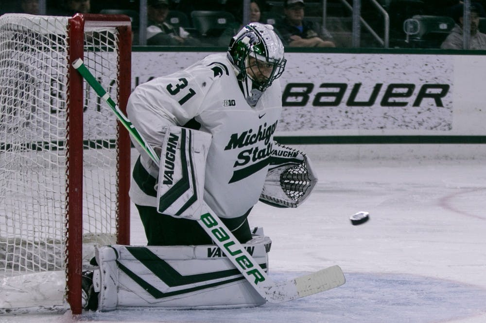 <p>Senior goalie John Lethemon (31) saves a shot during the game against Western Ontario at Munn Ice Arena on Oct. 7, 2019. The Spartans defeated the Mustangs, 6-1.</p>