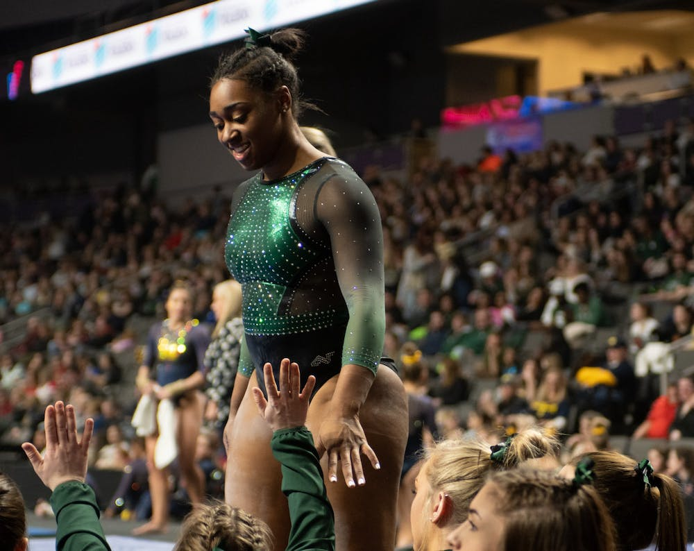 <p>Sophomore Alaina Raybon high fives her teammates on Feb. 22, 2020 during Elevate the Stage at the Huntington Center in Toledo, Ohio. </p>