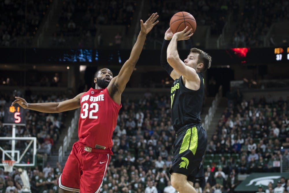 Freshman guard Jack Hoiberg (10) shoots over Ohio State guard Keyshawn Woods (32) during the men's basketball game against Ohio State at Breslin Center on Feb. 17, 2019. The Spartans defeated the Buckeyes, 62-44. Nic Antaya/The State News