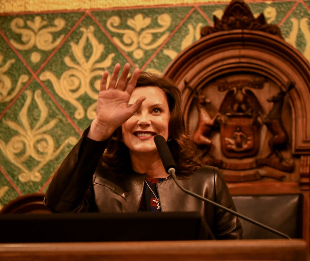 <p>Michigan Gov. Gretchen Whitmer waves to the crowd during her second State of the State address at the Michigan State Capitol in Lansing on Jan. 29, 2020.</p>