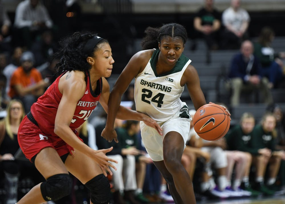 <p>Sophomore guard Nia Clouden (24) pushes past a defender during the women&#x27;s basketball game against Rutgers at the Breslin Center on Feb. 13, 2020</p>