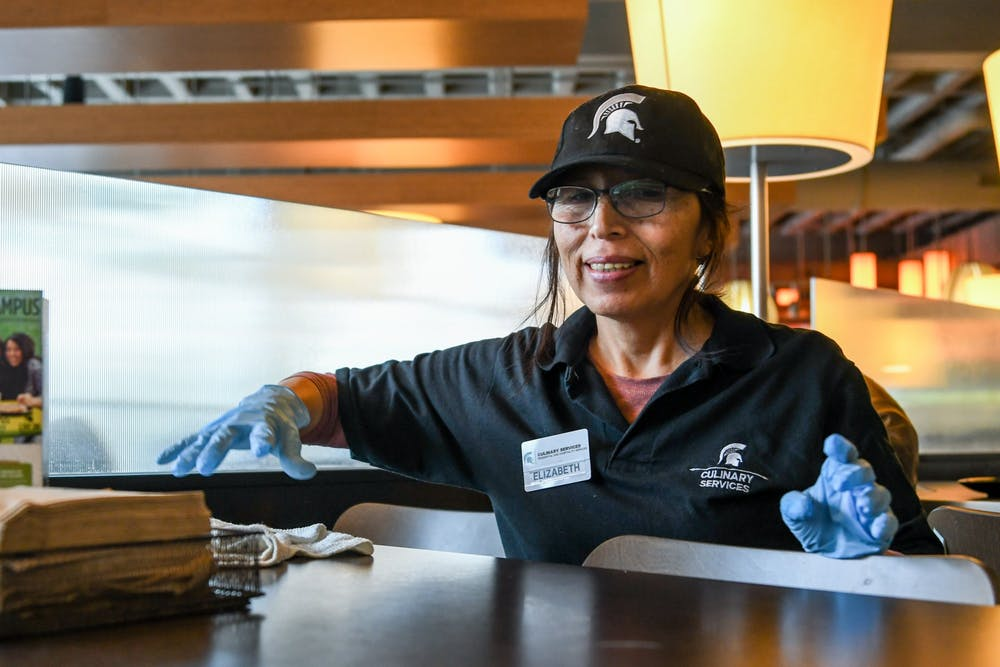 <p>Elizabeth, a dining hall employee, cleans the tables at Shaw on Jan. 23.</p>