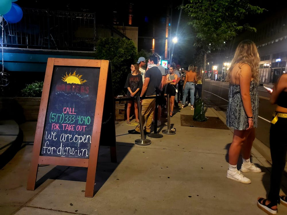 <p>The line at Harper&#x27;s Restaurant and Brewpub on June 8 following Michigan&#x27;s reopening of bars and restaurants at 50% capacity.</p>