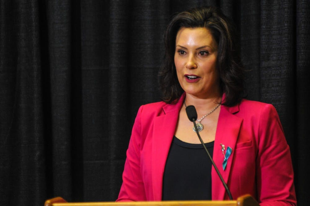Governor of Michigan Gretchen Whitmer speaks during the Finding Our Voice: Sister Survivors Speak Exhibition Opening Ceremony at the MSU Museum on April 16, 2019.